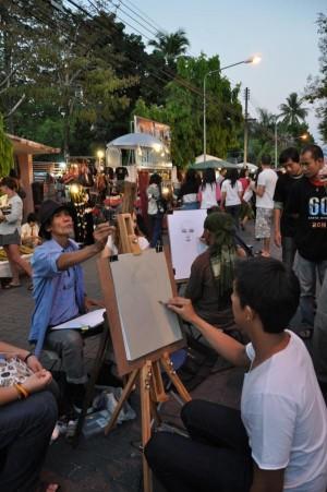 Künstler auf einem Markt in Chiang Mai